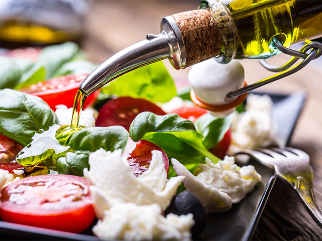 Low-calorie oriental Caprese snack: tomatoes with cheese and herbs