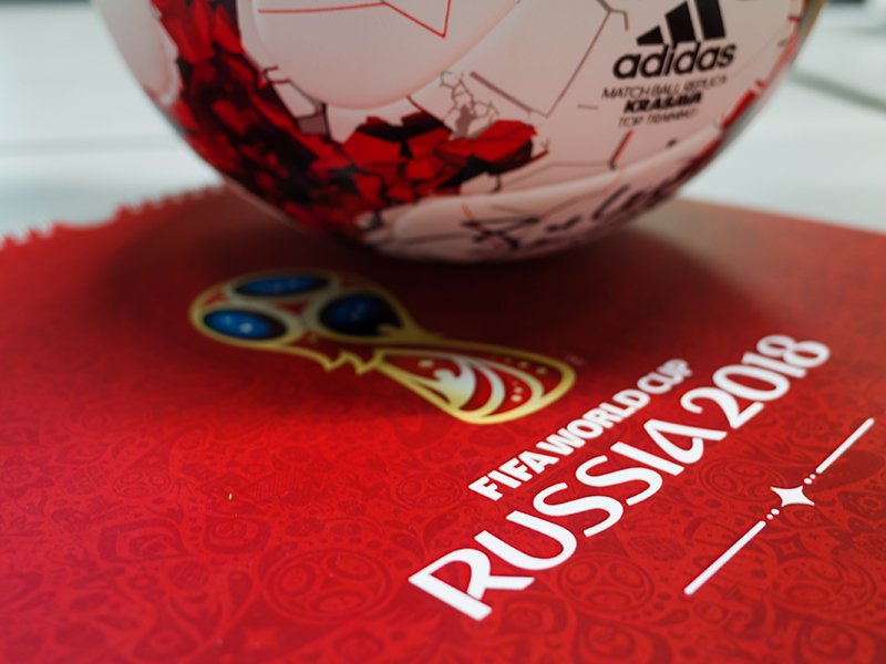 Russia's Official Adidas ball for the FIFA World Cup 2018, and a calendar with the symbols of the World Cup 2018.
